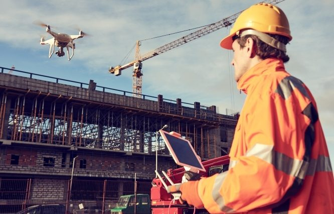 construction worker piloting a drone